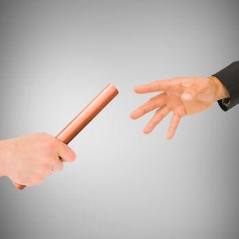 Athlete passing a baton to businessman