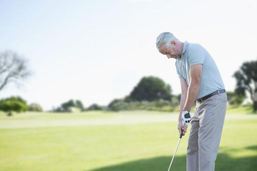 Focused man doing golf