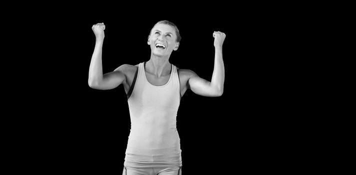 Athletic woman with arms up