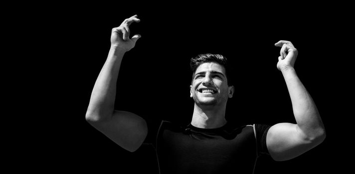 Portrait of happy sportsman