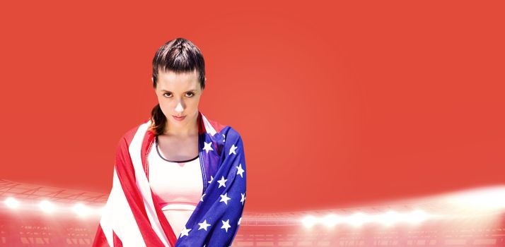 Composite image of portrait of sporty woman holding american flag
