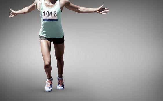 Composite image of sportswoman finishing her run
