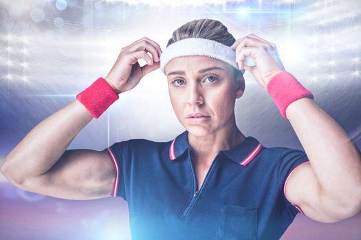 Composite image of female athlete adjusting her headband
