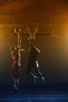 Basketballs player trying to scoring a basket