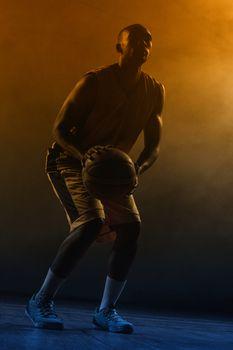Portrait of basketball player preparing to score
