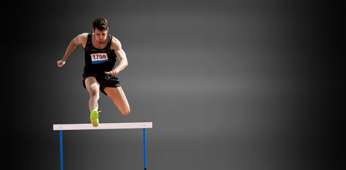 Sportsman practising hurdles