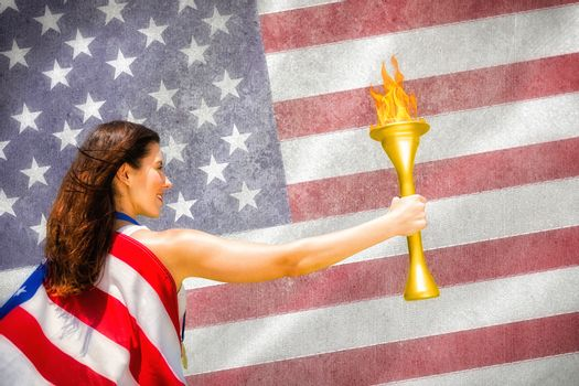 Composite image of rear view of american sportswoman holding a cup