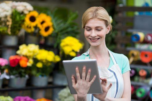 Female florist using digital tablet in florist shop