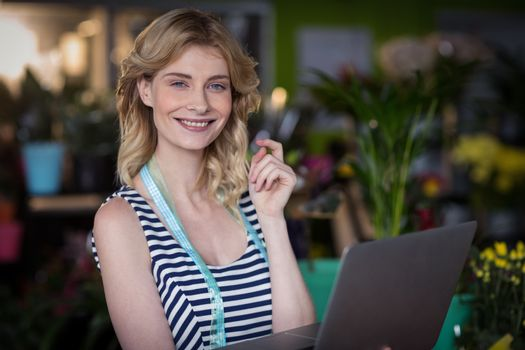 Female florist with the laptop