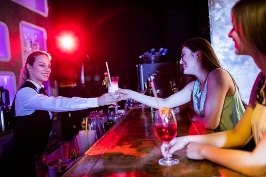 Waitress serving cocktail