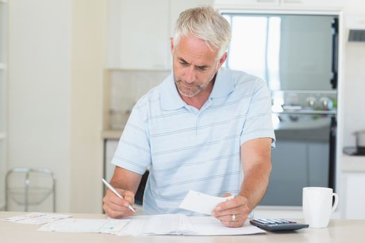 Concentrating man working out his finances