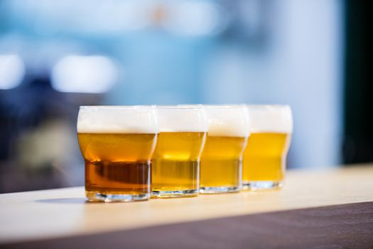 Close-up of beer glasses on the counter