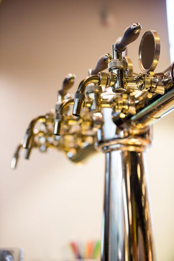 Close-Up of beer pump in a row