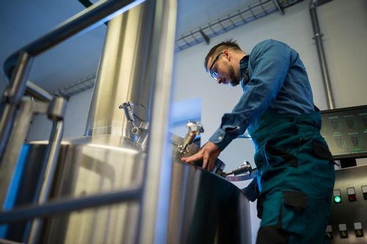 Maintenance worker working at brewery