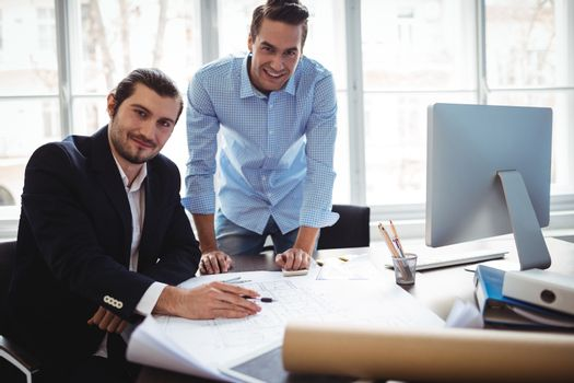 Portrait of smiling businessman with coworker