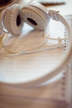 Headphones on spiral notebook