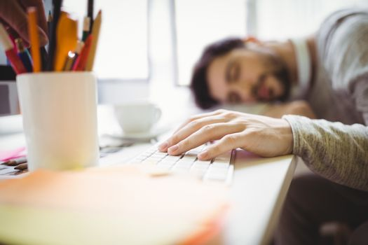 Businessman taking nap in office