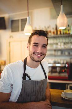 Portrait of confident barista at cafeteria