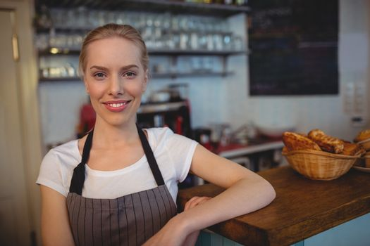 Portrait of attractive barista at cafe
