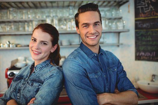 Portrait of happy baristas at coffee house