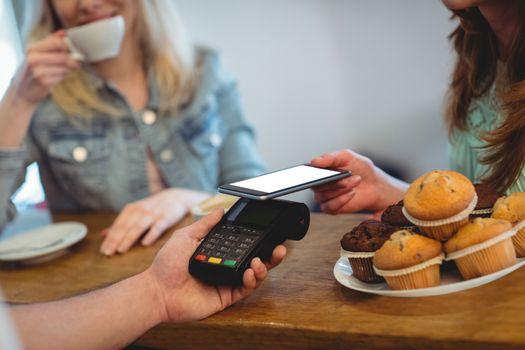 Customer paying through technology at cafe