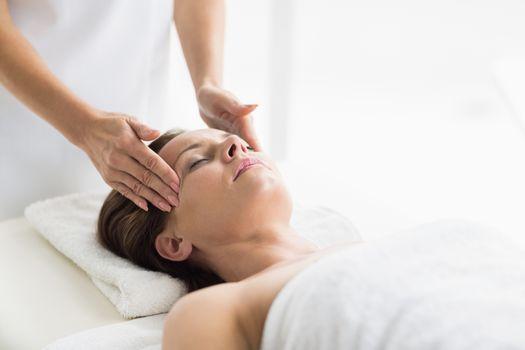 Masseur massaging woman