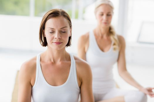 Women with eyes closed doing yoga