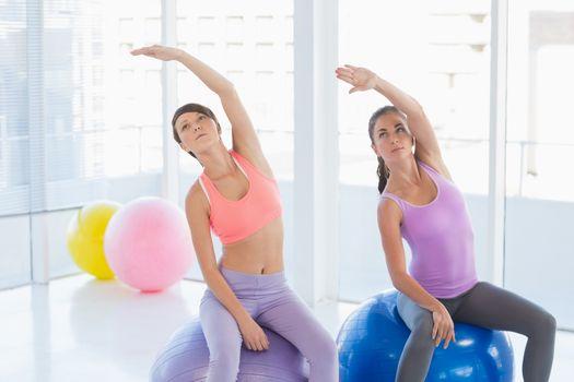 Women exercising in health club