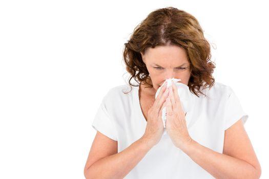 Irritated mature woman sneezing