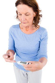 Diabetic mature woman taking blood sample
