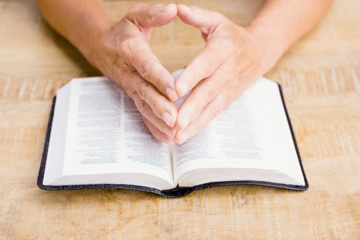 Person with bible at table
