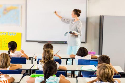 Teacher teaching schoolchildren