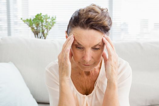 Close-up of irritated woman suffering from headache