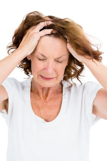 Irritated mature woman with head in hands