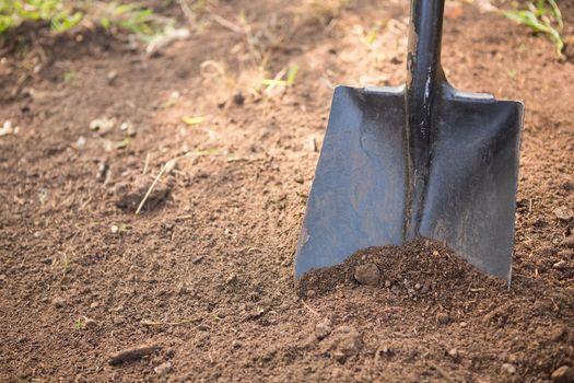 High angle view of shovel on dirt