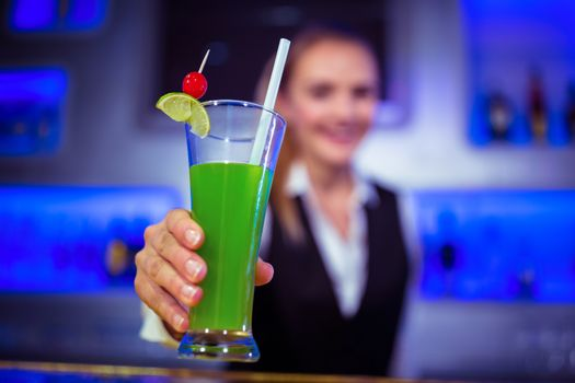 Barmaid serving cocktail