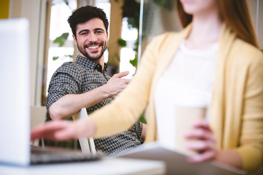 Smiling businessman with female coworker