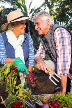 Happy couple gardening at botanical farm