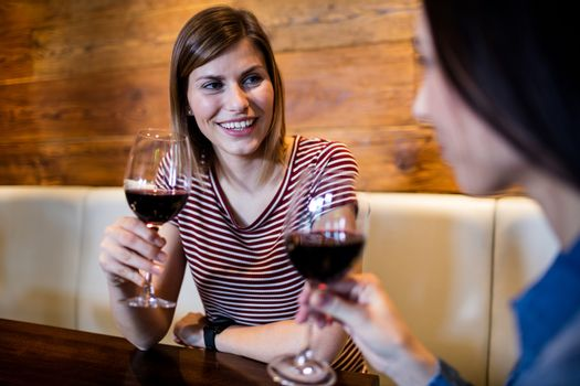 Female friends with wineglass