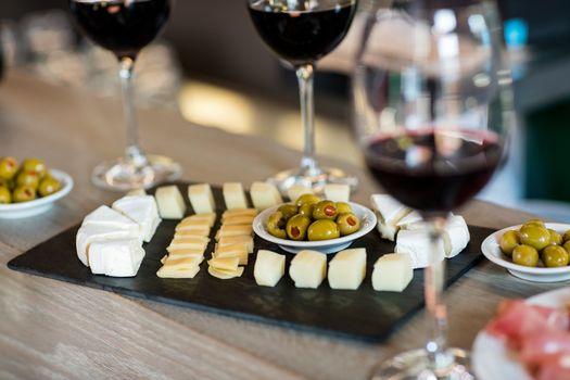 Wine and food arranged on table