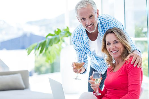 Couple with wineglass at home
