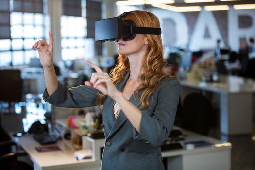 Businesswoman using virtual reality simulator