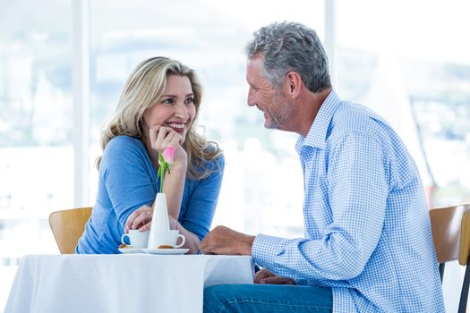 Romantic couple sitting in restaurant
