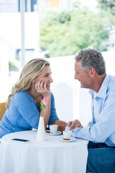 Romantic mature couple at restaurant