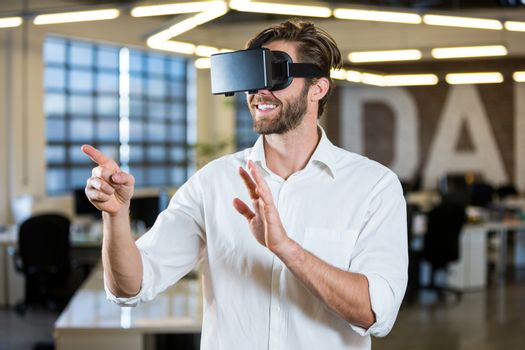 Businessman gesturing while using virtual reality simulator
