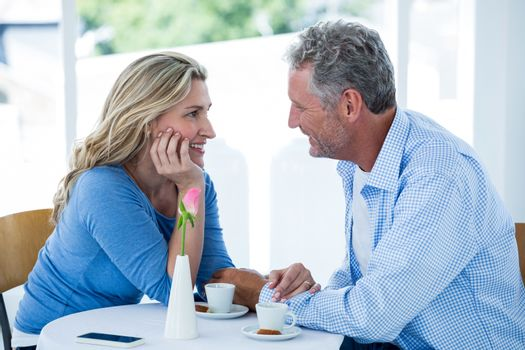 Romantic couple sitting at restaurant