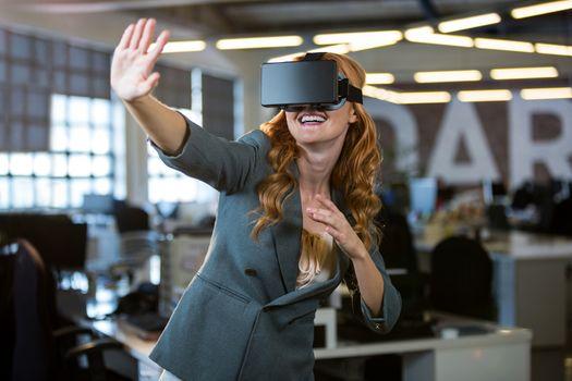 Cheerful woman using virtual reality simulator