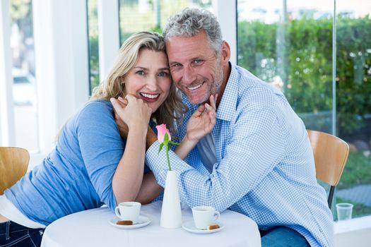 Portrait of romantic couple in restaurant