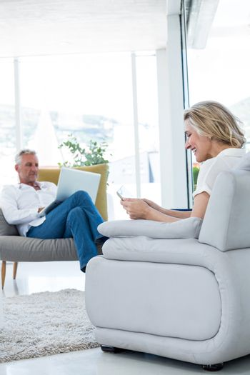 Couple using technology while sitting at home