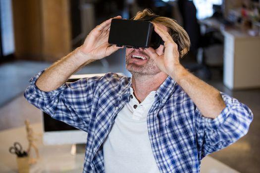 Smiling businessman using virtual reality simulator